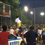 Basketball player wearing R.I.P. Eric Garner t-shirt dunks over NYPD patrol car: http://t.co/cIc4bGwHKz http://t.co/jh4hsApiAR