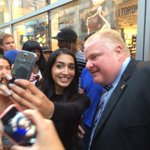 Rob Ford is a major celebrity. He hasnt moved from the same spot for 15 mins. Bombarded by selfie requests #Toronto http://t.co/FjJk9DzP30