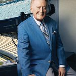 RT @THR: Vin Scully is returning for his 66th year with the #Dodgers. Here he is posing for THR earlier this month. http://t.co/FmNCTsmYcV
