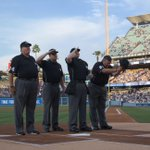 Before the game, tonights umpires saluted #VinScully on his talking mic giveaway night. Little did they know ... http://t.co/ZpFIpt8vFV
