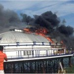 RT @BBCEngland: Eastbourne Pier fire: Thick smoke is seen coming from arcade building http://t.co/h0q5QAWJwE http://t.co/VK46Otu41p