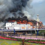 RT @BBCEngland: Eastbourne Pier fire: Photographs show the entire arcade building roof ablaze http://t.co/VGNzfCPV19 http://t.co/X7Gh35IH4O