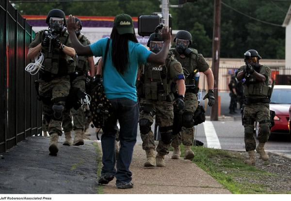 Summing up police militarization with a photo from Missouri. The camo is required because? http://t.co/Jr6atNWxjR http://t.co/IeZgZNppxl