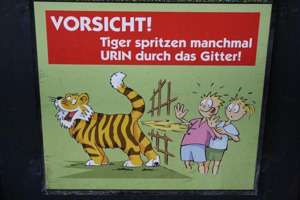 @Rubberasylum @krinndnz RT @TorinDarkflight Warning sign at a zoo. The tiger just looks so HAPPY! XD http://t.co/egDb309NhK