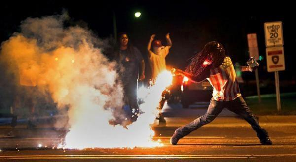 """Hey Captain America, do you need me to hold your chips while you throw that tear gas back?""  ""Naw, man, I'm good."" http://t.co/Zz9bG1ymI9"