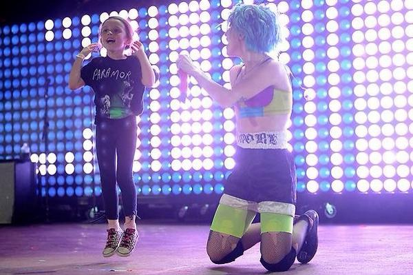 Photos of @paramore with an adorable fan on stage at Denver. ☺️ http://t.co/sL34g6bvUm