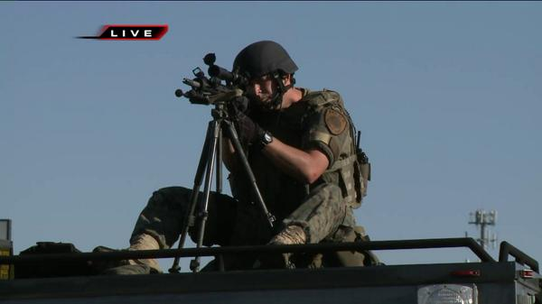 The #STL SWAT team has weapons drawn in #Ferguson at a protest in broad daylight with media attending http://t.co/z6zIVuCM6D