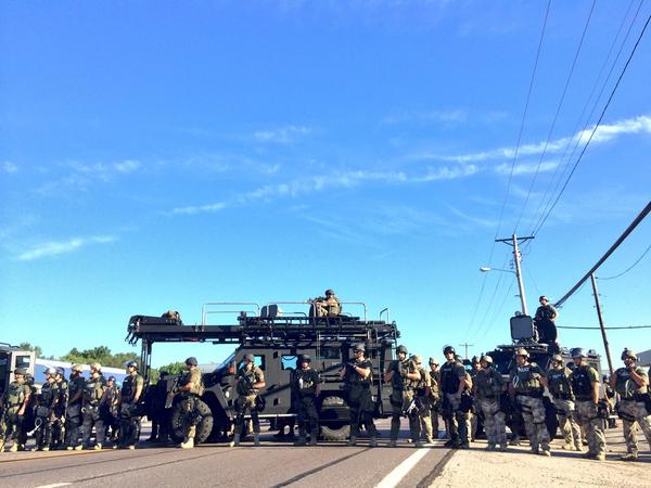 This should be un-American. RT @ryanjreilly: I counted 70+ SWAT officers. Guns trained on crowds. Insanity. http://t.co/4bCiHvbQIG