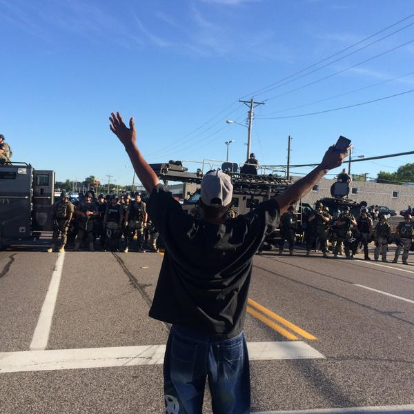 On some Tiananmen shit. RT @sebwalker: Military-style police: 3 APCs, ~100 officers, high-powered rifles #Ferguson http://t.co/JK0ZBrnEIO