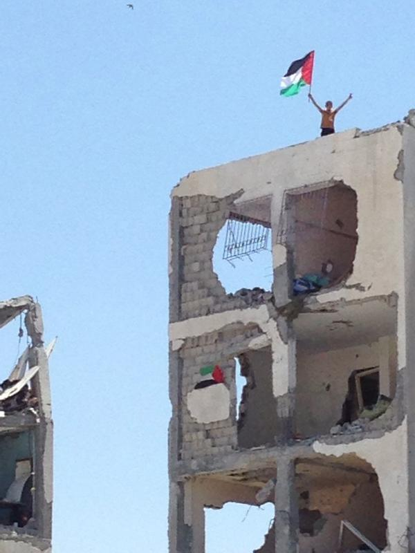 Even amidst ruins there are those determined to show defiance #gaza @itvnews http://t.co/Ymsfbszt1b