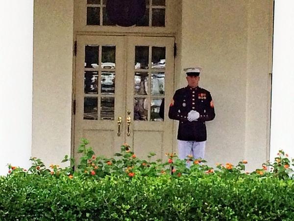 US Marine sentry at White House West Wing door today indicating President in Oval Office  & Us marine sentry at white house west wing door today indicating ...