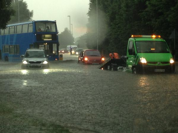 Flash flooding in Cambridgeshire traps drivers, closes shops and cuts off power http://t.co/qqR71zL47J http://t.co/TloWLt21nO