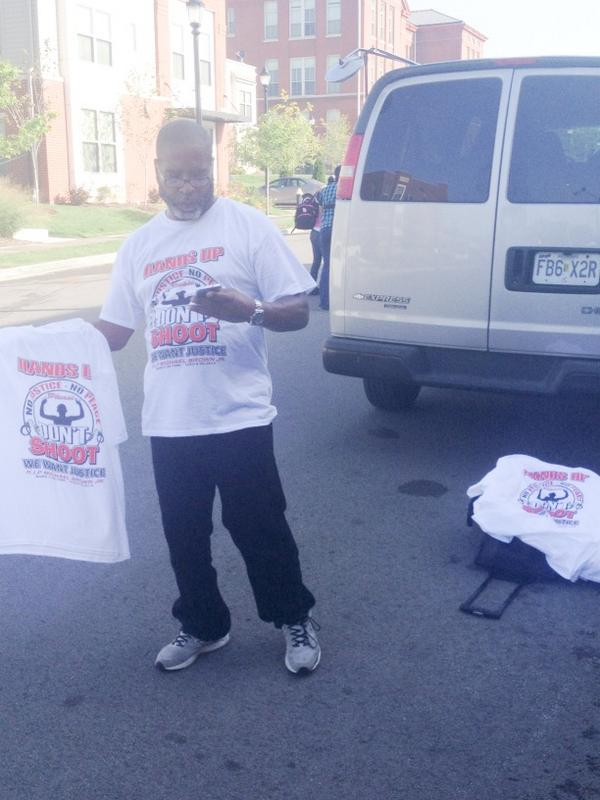 """Get your memorial T-shirts! $10!"" -- outside funeral for Michael Brown. http://t.co/ksvHV57PnC"