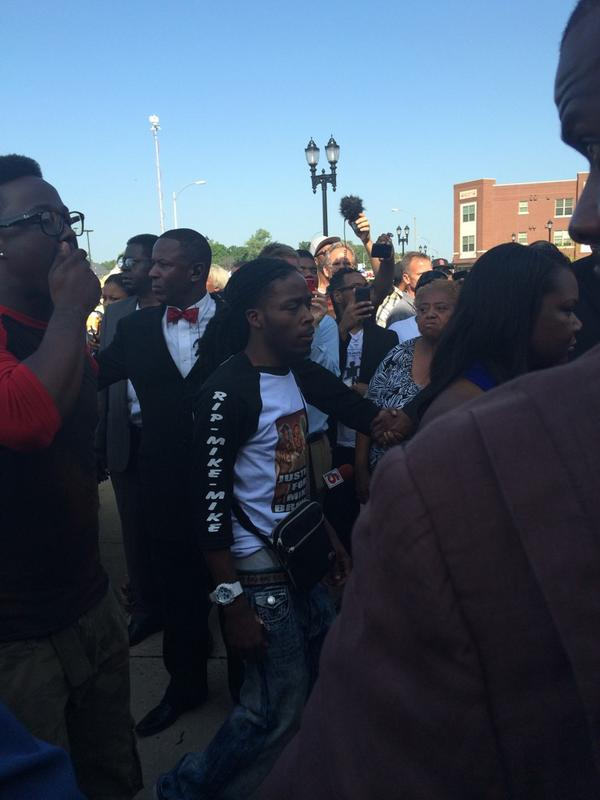 #MikeBrown's dad has arrived. With him was Dorian Johnson a key witness to the shooting. http://t.co/HozEle2utm