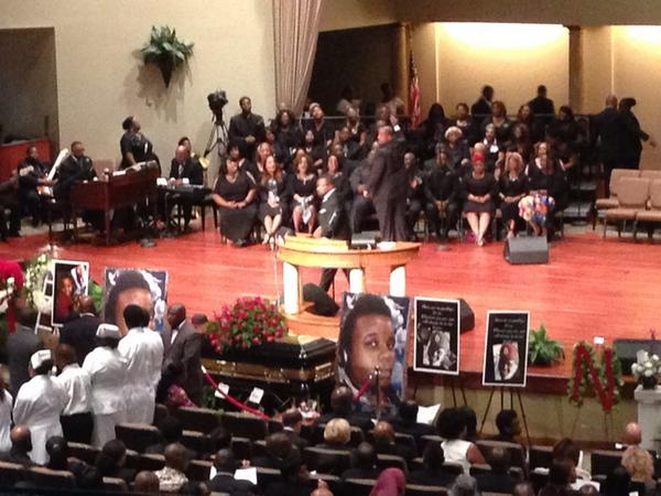 "Choir sings hymn, ""Jesus is Worthy,"" ahead of arrival of about 600 of #MikeBrown's family members. http://t.co/GRsqIK1TzZ"