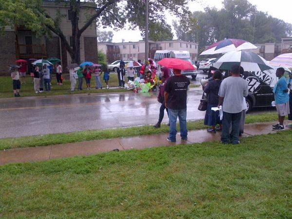 #RIPMichaelBrown This moment a week ago #MichaelBrown lost his life at this spot. Demonstrators out in rain. http://t.co/toq8kppFWj