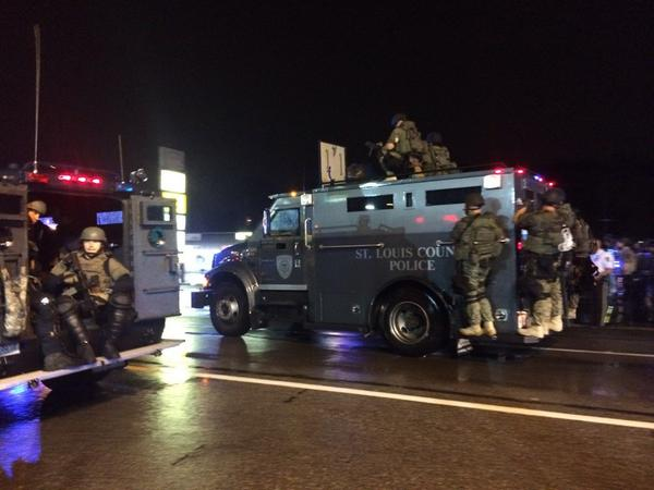 SWAT team moving in demanding that protestors violating curfew get out of the street: #Ferguson @ABC http://t.co/ZfL63a5Ods