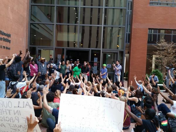 "Today: protesters chant ""Hands up, don't shoot"" in front of Gov. Jay Nixon's office. #Ferguson http://t.co/TKRflm2qGA"