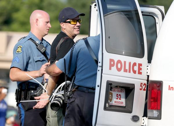 Getty photographer Scott Olson is placed in a paddy wagon after being arrested in #Ferguson | Getty Images http://t.co/5Ou0av4q57