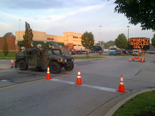 31 arrested overnight after clashes with police. Missouri Nat'l Guard here. Quiet morning. #Ferguson http://t.co/lFlRlEa5Pl