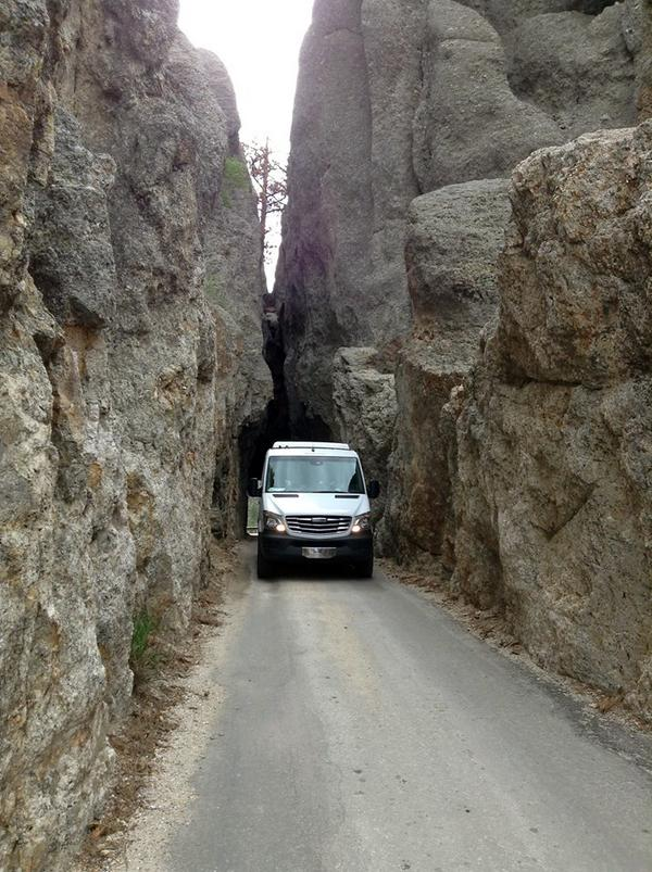 Ned sent us this photo of his Sprinter going through Needles Highway in Custer State Park, SD. Tight squeeze! http://t.co/uLbzEqdv5O