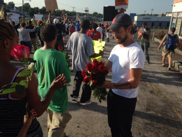 STL native and @twitter co-founder @jack passing out roses to demonstrators on w florissant #Ferguson http://t.co/eHclLN2wv0