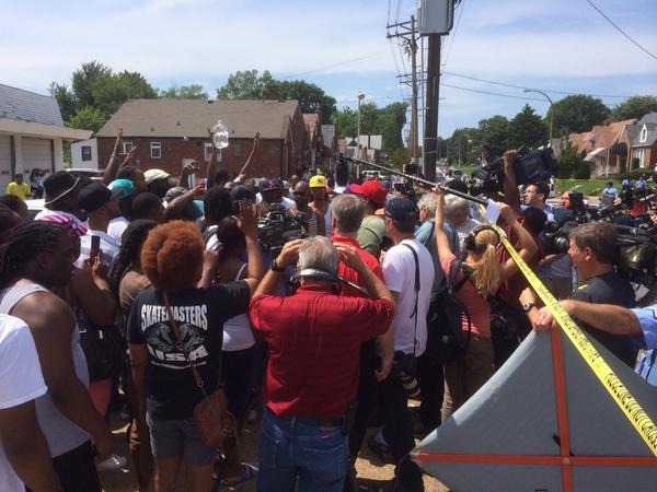 Furious crowd at scene of officer-involved shooting four miles from #Ferguson. Cops say suspect brandished knife. http://t.co/1Hv8lhtBQq
