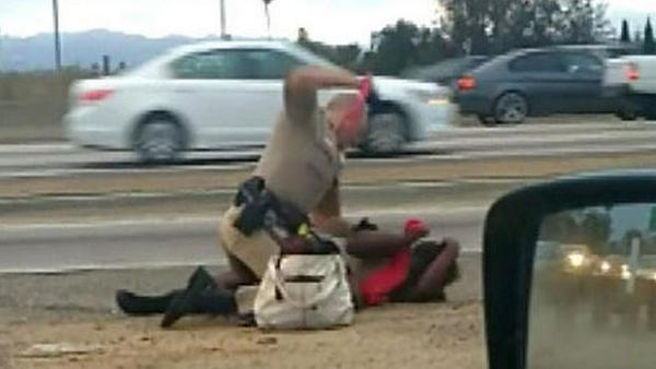 """CHP officer who beat woman relieved of duty, faces """"potentially serious charges."""" http://t.co/M4F4TdRRiK http://t.co/7AwyoO838B"""