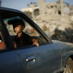 A Palestinian boy fleeing with his family looks out of a car window in #Gaza. - Reuters #GazaUnderAttack http://t.co/v8iEIq0TcZ