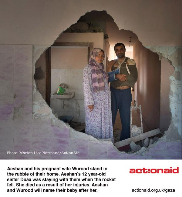 Photo of the week: Aeshan and his pregnant wife Wurood stand amongst the rubble of their home in #Gaza http://t.co/6YTWPopCPb
