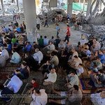 This is how people in Gaza prayed on top of their destroyed mosque yesterday on Friday prayer. http://t.co/55aPKtZ36f @Presiden2014com