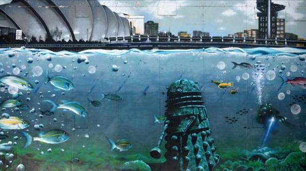 In honour of Dr Who starting back tonight here's a mural, Sunken Dalek, you can find on Clyde Street in Glasgow. http://t.co/15aasxFVht