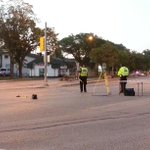 Police investigate crash. Beer cans, flip flops and a purse seen in street. Woman in critical. Street closed.#cbcmb http://t.co/lk0DCUYCYz