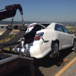 Damaged car being towed after being hit by semi truck http://t.co/QsaEL9MBcc