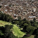 Kibera. Africas largest slum borders a golf course & palace of a former president of Kenya. #MoiAt90 http://t.co/K0yHpMnF0s