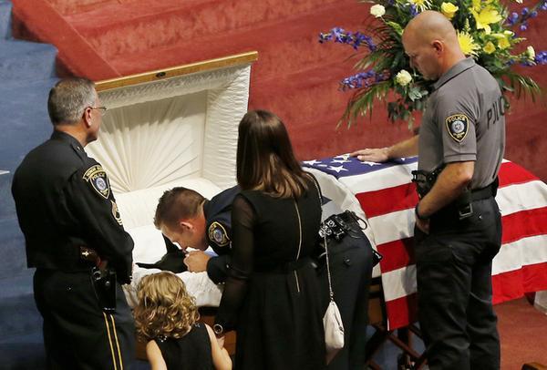 Sgt. Ryan Stark says goodbye to his K-9 partner Kye, at Kye's funeral yesterday. #RIPKye http://t.co/5yO0RcUfVz
