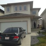 """RT @BillFortierCTV: Officer guards the door of a Southeast #yeg home, where a woman was found dead. Police call the death """"suspicious"""". http://t.co/fM3UroEyST"""