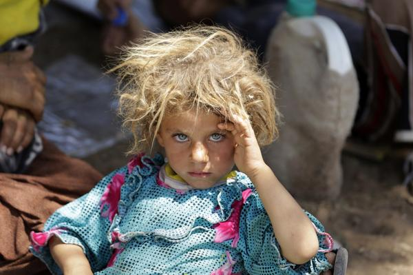 Amazing pic of Yezidi girl after escaping the orcs in Iraq. Those eyes.   http://t.co/tKDNrkrqvP http://t.co/O4Qt9QyarH (via @Reuters)