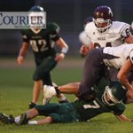 Waterloo Columbus QB Kyle McMahon slides under tackle of Independences Jake Juhl #iahsfb http://t.co/iFZ7BB1jf2