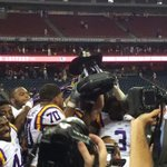 RT @LSUfball: The Tigers with the trophy after a 28-24 comeback win against Wisconsin! #LSU http://t.co/YP0WZKt9Zb