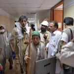 #Picture Supporters TuQ & Imran Khan hold sticks as they enter the headquarters of PTV, Islamabad. -AFP http://t.co/PeHCWQWH8d