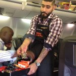 RT @SFGiants: Talk about a #HappyFlight @SergioRomo54 handing out candy to the #SFGiants en route to Colorado #CandyMan http://t.co/5VdGnSzORr