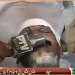 Associate of SSP Islamabad attacked by protesters. http://t.co/vJnZifD8kh