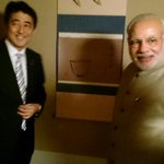 Memories of the past. PM @AbeShinzo shows @PMOIndia of his grandfather Fmr PM Kishis visit to India in 1950s. http://t.co/mfrbEQta1E