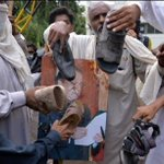 Protesters at PTV Headquarters hitting Prime Minister Nawaz Sharifs portrait with shoes (taken early today) http://t.co/hLpRcHFGlr