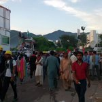 RT @shumail365: Random Photograph taken few seconds ago, from Inqilab/Azadi March. IK, TUQ containers visible #AwamiPressure http://t.co/EAMkocVKz1
