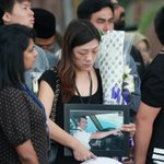 RT @NST_Online: #MH17: A family member Capt Eugene Choo Jin crying as she hold his photo while #MH19 arrives at Bunga Raya Complex http://t.co/zDMjJWaKJJ