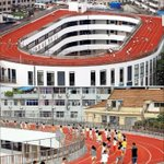 OUT OF SPACE, NOT IDEAS: Students exercise on a track on the rooftop of campus building at a primary school in China http://t.co/sKPDC3lVGo
