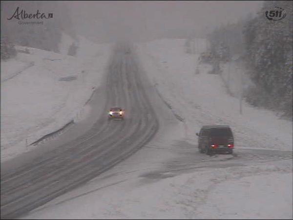And... it's snowing. @511Alberta camera from Hwy 22 near Ranchlands. #SeptemberSnow #yyc #gross http://t.co/hBOFAvFahR