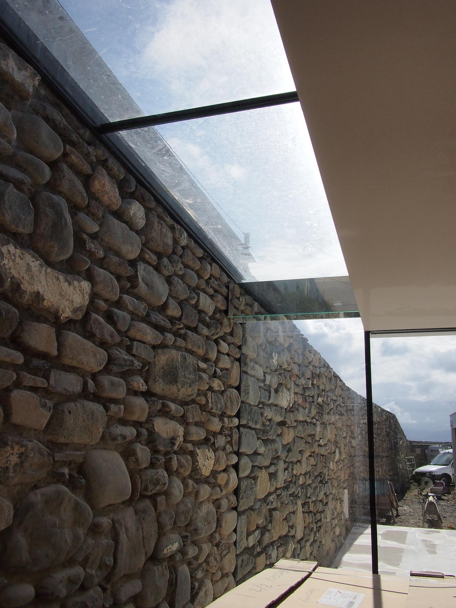RT @clear_living: #structural glass rooflight with #skyframe doors going into this stone walling. Will be on tonights #granddesigns http://t.co/TyppOdO97c